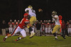 Baldwinsville Bees Josh Greer (84) hits West Genesee Wildcats Quarterback Dashon Turner (11) as he pitches the ball to Joey Vetter (44) at Pelcher-Arcaro Stadium in Baldwinsville, New York on Friday, September 12, 2014. Baldwinsville won 36-7.