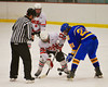 Baldwinsville Bees James Pelcher (17) faces off against the Cortland-Homer Golden Eagles Victor McCutcheon (21) at the Greater Baldwinsville Ice Arena in Baldwinsville, New York.  Baldwinsville won 5-1.