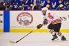 Baldwinsville Bees Tom Ancillotti (8) heads into the Cortland-Homer Golden Eagles zone at the Greater Baldwinsville Ice Arena in Baldwinsville, New York.  Baldwinsville won 5-1.