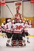 Baldwinsville Bees players swarm goalie Matt Sabourin (31) after beating the Liverpool Warriors 4-0 at the Greater Baldwinsville Ice Arena in Baldwinsville, New York on Tuesday December 2, 2014.