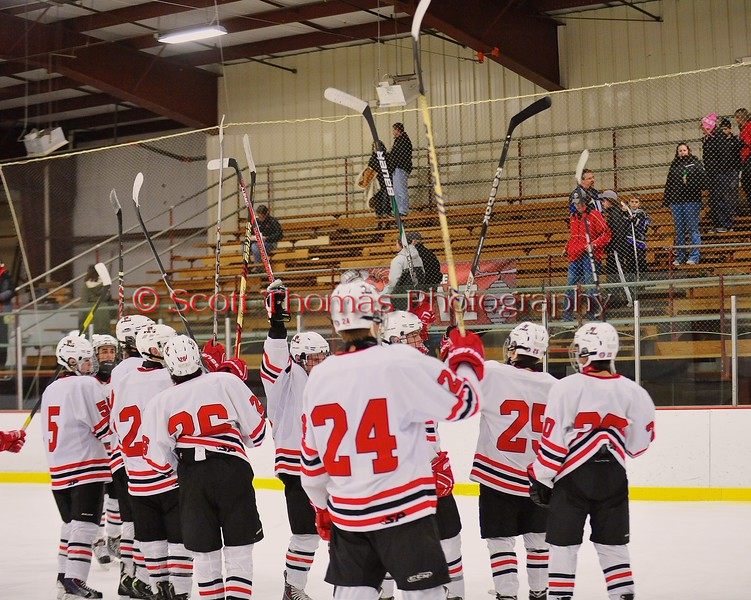Baldwinsville Bees salute the fans after defeating the Liverpool Warriors at the Greater Baldwinsville Ice Arena in Baldwinsville, New York on Tuesday December 2, 2014.  Baldwinsville won 4-0.