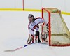 Baldwinsville Bees goalie Matt Sabourin (31) picks up his stick after losing it against the Oswego Buccaneers at the Greater Baldwinsville Ice Arena in Baldwinsville, New York on Tuesday January 27, 2015.  Baldwinsville won 4-0.