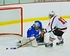 Baldwinsville Bees Joe Glamos (18) is stopped by Oswego Buccaneers goalie Jarrett Dudley (30) at the Greater Baldwinsville Ice Arena in Baldwinsville, New York on Tuesday January 27, 2015.  Baldwinsville won 4-0.