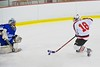 Baldwinsville Bees Joe Glamos (18) breaking at the Oswego Buccaneers goalie Jarrett Dudley (30) at the Greater Baldwinsville Ice Arena in Baldwinsville, New York on Tuesday January 27, 2015.  Baldwinsville won 4-0.