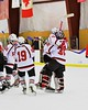 Baldwinsville Bees Charlie Bertrand (15) hugs goalie Matt Sabourin (31) after shutting out the Oswego Buccaneers at the Greater Baldwinsville Ice Arena in Baldwinsville, New York on Tuesday January 27, 2015.  Baldwinsville won 4-0.