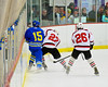 Baldwinsville Bees Matt Metcalf (27) checks West Genesee Wildcats Derek Farrell (15) at the Greater Baldwinsville Ice Arena in a Section III Division I Boys Hockey Playoff game at Baldwinsville, New York on Tuesday February 24, 2015.  Baldwinsville won 5-0.