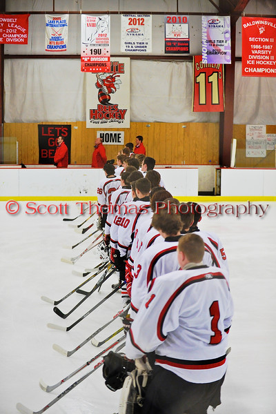 Baldwinsville Bees lined up along the blue line for the National Anthem at the Greater Baldwinsville Ice Arena in a Section III Division I Boys Hockey Playoff game at Baldwinsville, New York on Tuesday February 24, 2015.  Baldwinsville won 5-0.