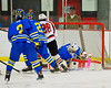 West Genesee Wildcats goalie Nick Skidmore (35) makes a save against Baldwinsville Bees Kyle Lindsay (26) at the Greater Baldwinsville Ice Arena in a Section III Division I Boys Hockey Playoff game at Baldwinsville, New York on Tuesday February 24, 2015.  Baldwinsville won 5-0.