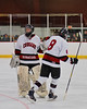 Syracuse Cougars goalie Sam Walsh (28) and Ryan Lehner (8) celebrate a goal against the West Genesee Wildcats at Meachem Ice Rink in Syracuse, New York on Wednesday, January 28, 2015. Syracuse won 5-4.