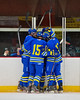 West Genesee Wildcats players celebrate a goal against the Syracuse Cougars at Meachem Ice Rink in Syracuse, New York on Wednesday, January 28, 2015. Syracuse won 5-4.