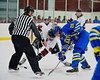 West Genesee Wildcats Andrew Katko (26) facing off against Syracuse Cougars Colin Thompson (9) at Meachem Ice Rink in Syracuse, New York on Wednesday, January 28, 2015. Syracuse won 5-4.
