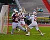 Auburn Maroons goalie Maxwell Hogan (20) makes a save on Baldwinsville Bees Ryan Gebhardt (20) in Section III Boys Lacrosse action at the Pelcher-Arcaro Stadium in Baldwinsville, New York on Monday, April 27, 2015..  Auburn won 14-10.