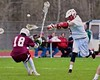 Baldwinsville Bees Peter Fiorni III (13) shoots and scores past Auburn Maroons Danny Entenmann (18) in Section III Boys Lacrosse action at the Pelcher-Arcaro Stadium in Baldwinsville, New York on Monday, April 27, 2015..  Auburn won 14-10.