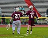 Auburn Maroons goalie Maxwell Hogan (20) gets a high five from Maroons Joe Butera (17) after making a save agains the Baldwinsville Bees in Section III Boys Lacrosse action at the Pelcher-Arcaro Stadium in Baldwinsville, New York on Monday, April 27, 2015..  Auburn won 14-10.