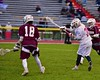 Baldwinsville Bees Connor Smith (26) fires a shot at the Auburn Maroons net in Section III Boys Lacrosse action at the Pelcher-Arcaro Stadium in Baldwinsville, New York on Monday, April 27, 2015..  Auburn won 14-10.