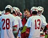 Baldwinsville Bees Head Coach Matt Wilcox going over a play with his team during a timeout in a game against the Auburn Maroons in Section III Boys Lacrosse at the Pelcher-Arcaro Stadium in Baldwinsville, New York on Monday, April 27, 2015..  Auburn won 14-10.