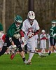 Fayetteville-Manlius Hornets Erik Badger (22) gets the ball knocked out of his stick by Baldwinsville Bees Jake Anderson (22) in Section III Boys Lacrosse action at the Pelcher-Arcaro Stadium in Baldwinsville, New York on Friday, May 1, 2015..  Baldwinsville  won 11-9.