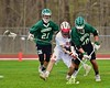 Baldwinsville Bees Dillon Darcangelo (10) goes after a ground ball with Fayetteville-Manlius Hornets Ryan Miller (20) as hornets defensemen Owen Penoyer (21) coming for support in Section III Boys Lacrosse action at the Pelcher-Arcaro Stadium in Baldwinsville, New York on Friday, May 1, 2015..  Baldwinsville  won 11-9.