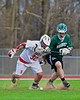 Baldwinsville Bees Evan Stolicker (32)  and Fayetteville-Manlius Hornets Thomas Ryu (9) during a face-off in Section III Boys Lacrosse action at the Pelcher-Arcaro Stadium in Baldwinsville, New York on Friday, May 1, 2015..  Baldwinsville  won 11-9.