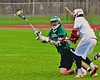 Fayetteville-Manlius Hornets Dylan Taylor-Wolford (27) gets a shot off while bing knocked down by a Baldwinsville Bees defender in Section III Boys Lacrosse action at the Pelcher-Arcaro Stadium in Baldwinsville, New York on Friday, May 1, 2015..  Baldwinsville  won 11-9.