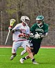 Baldwinsville Bees Evan Stolicker (32) is checked by Fayetteville-Manlius Hornets Dylan Taylor-Wolford (27) in Section III Boys Lacrosse action at the Pelcher-Arcaro Stadium in Baldwinsville, New York on Friday, May 1, 2015..  Baldwinsville  won 11-9.