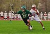 Fayetteville-Manlius Hornets Dylan Taylor-Wolford (27) comes away with a loose ball against Baldwinsville Bees Peter Fiorni III (13) in Section III Boys Lacrosse action at the Pelcher-Arcaro Stadium in Baldwinsville, New York on Friday, May 1, 2015..  Baldwinsville  won 11-9.