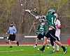 Fayetteville-Manlius Hornets Tyler Papa (14) gets a shot off at the Baldwinsville Bees net in Section III Boys Lacrosse action at the Pelcher-Arcaro Stadium in Baldwinsville, New York on Friday, May 1, 2015..  Baldwinsville  won 11-9.
