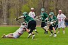 Baldwinsville Bees Charlie Bertrand (6) shoots and scores as he is knocked down by a Fayetteville-Manlius Hornets player in Section III Boys Lacrosse action at the Pelcher-Arcaro Stadium in Baldwinsville, New York on Friday, May 1, 2015..  Baldwinsville  won 11-9.