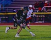 Syracuse Cougars Sean Eccles (13) gets one of many ground balls the Cougars grabbed from the Baldwinsville Bees in Section III Boys Lacrosse Quarter Final Playoff action at the Pelcher-Arcaro Stadium in Baldwinsville, New York on Wednesday, May 20, 2015.  Syracuse won 12-9.