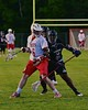 Baldwinsville Bees Charlie Bertrand (6) being checked by Syracuse Cougars Isaiah Robinson (5) in Section III Boys Lacrosse Quarter Final Playoff action at the Pelcher-Arcaro Stadium in Baldwinsville, New York on Wednesday, May 20, 2015.  Syracuse won 12-9.