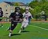 Syracuse Cougars Sterling Claflin (19) being defended by Auburn Maroons Reed Chronis (14) in Section III Boys Lacrosse Semi-Final game at the Michael J. Bragman Stadium in Cicero, New York on Saturday, May 23, 2015.  Auburn won 14-6.