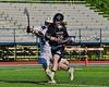 Syracuse Cougars Sean Eccles (13) winding up for a shot at the Auburn Maroons net in Section III Boys Lacrosse Semi-Final game at the Michael J. Bragman Stadium in Cicero, New York on Saturday, May 23, 2015.  Auburn won 14-6.