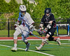 Auburn Maroons Reed Chronis (14) gets the ball knocked out of stick by Syracuse Cougars Sterling Claflin (19) in Section III Boys Lacrosse Semi-Final game at the Michael J. Bragman Stadium in Cicero, New York on Saturday, May 23, 2015.  Auburn won 14-6.