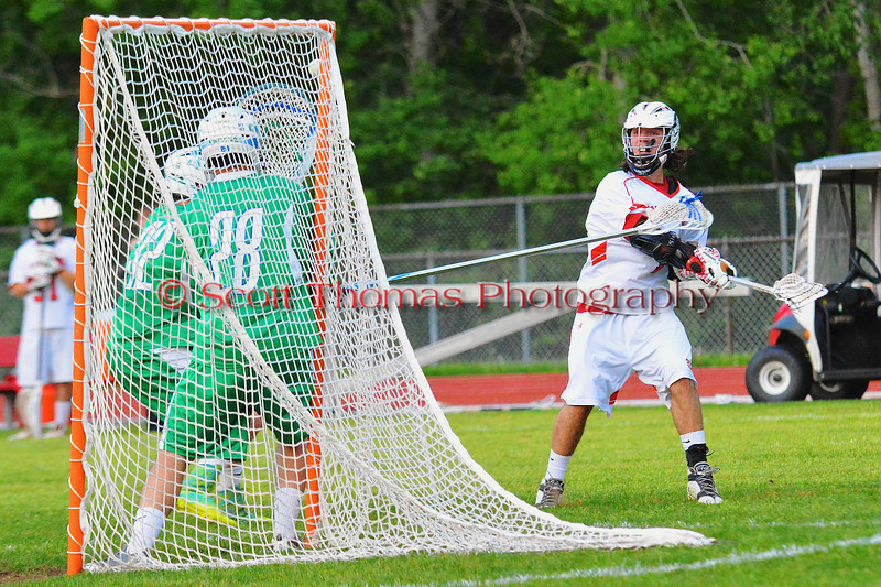 Baldwinsville Bees Zachary Bulak (1) threads the needle to score in the opening minute of the second quarter against the Cicero-North Syracuse Northstars in Class A quarterfinal Section III Boys Lacrosse action at the Pelcher-Arcaro Stadium in Baldwinsville, New York.