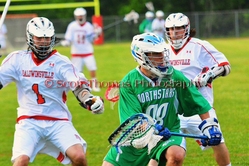 Cicero-North Syracuse Northstars goalie Bryan Schenk (28) surrounded by Baldwinsville Bees Zachary Bulak (1) and Dakota Luke (3) in Class A quarterfinal Section III Boys Lacrosse action at the Pelcher-Arcaro Stadium in Baldwinsville, New York.
