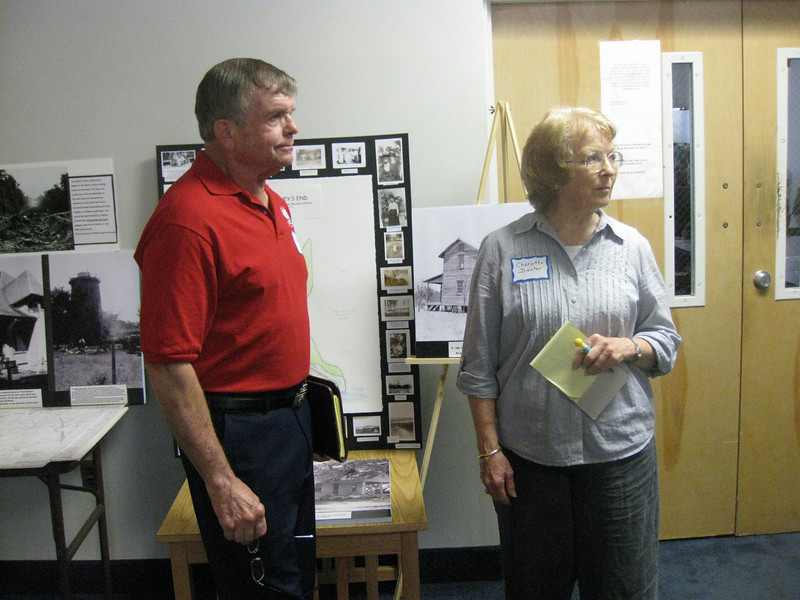 Kim Kimbell, author and base historian and historian for proposed Marine Corps Museum of Onslow, along with Charlotte Dexter, observe reunion arrivals.