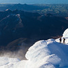 Taranaki climber Phill Davies and author Paul Hersey on Mt Taranaki. Looking out to Pouakai Range and NW coast