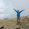 <b>16 August 2014</b> Miles on the summit of Bourgeau, looking majestic. Clouds starting to clear.