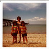 Bill Amy Jody at a beach.. This is neat bridge but not sure where it is exactly.  Norther Michigan?