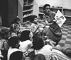 1960, JUDIE READING TO NURSERY CLASS copy