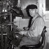 """Lawrence """"Doc"""" Hahn (1906-2000)  Doc Hahn worked more than 50 years at the newspaper, taught school in Marble Hill (Grades 6,7,8) and helped to establish the Bollinger County Museum.  Here he is seen at the linotype machine in """"Banner Press"""" office."""
