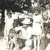 64. Uncle John Barr with calf at the Dripping Springs farm. From left, Lee,Jr, Donna, Betty and Harry Jr.