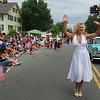 Marilyn Monroe impersonator Theresia Millasovich of Boston Party Adventures entertains at the Chelmsford 4th of July parade, followed by a vintage Lincoln. (SUN/Julia Malakie)