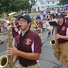 Front, from left, Nick Zaher and Geoff Stewart on tenor sax, and Hannah Przybilowicz on tuba, march with the Chelmsford High School Band. (SUN/Julia Malakie)