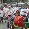 The ABC Nursery School (front) and Enterprise Bank (white shirts) participate in the Chelmsford 4th of July parade. (SUN/Julia Malakie)