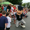 New England Patriots mascot greets spectators at the Chelmsford 4th of July parade. (SUN/Julia Malakie)