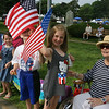 From left, twins Brooke and Zack Gilroy, 6, and their sister Paige Gilroy, 7, at their first-ever parade, with grandmother  Ellie Gilroy of Chelmsford. (SUN/Julia Malakie)