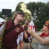 Chelmsford High Band mom Roberta Nicoletta offers water to tenor sax player Geoff Stewart, 16. (SUN/Julia Malakie)