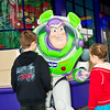 Buzz Lightyear takes time out from protecting the universe to say hello to a couple of fans.