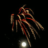 full moon behind the fireworks